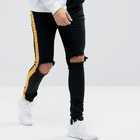 Sixth June Super Skinny Jeans In Black With Yellow Stripe And Distressing at asos.com