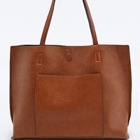 Reversible Vegan Leather Pocket Tote Bag in Tan and Black - Urban Outfitters