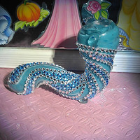 Blue and silver zebra print WORM shaped pipe