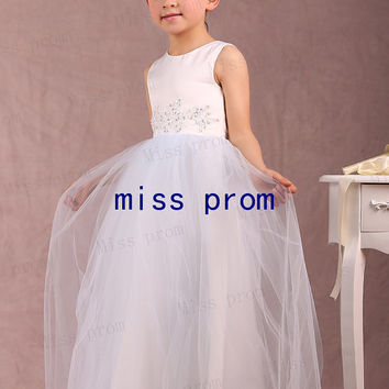 Lovely floor-length flower girl dress made of tulle with appliques and sequins