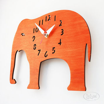 The Oh My Orange Elephant designer wall mounted clock by LeLuni