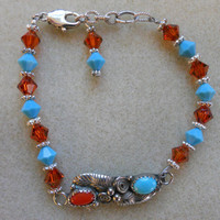 Swarovski Beaded Bracelet with Sterling Silver Center Piece of Coral and Turquoise Stones.....