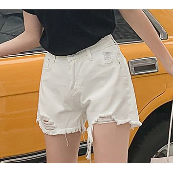 Ultra short black and white solid color broken holes show slim loose high waist denim shorts