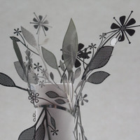 Metal foliage wrapped around a fine bone china tall tube