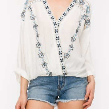 embroidered wrap blouse with rolled sleeve