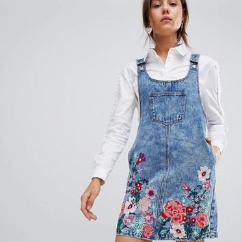 Glamorous Mini Pinafore Dress With Floral Embroidery In Denim at asos.com