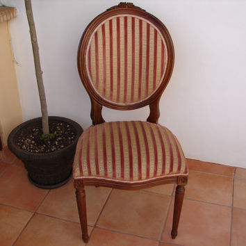 50% OFF EVERYTHING Antique French walnut,carved Louis Chair with original pink & striped fabric,carved flower detail.