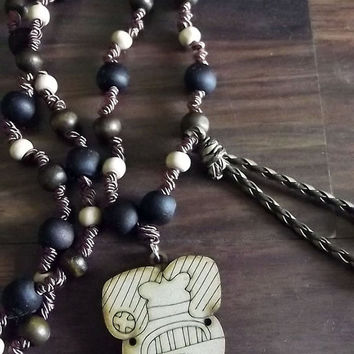 Vinal Uayeb Maya. Maya lunar calendar. Along with jojoba, wood and silk thread necklace. Charm wood pyrography Uayeb.