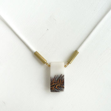 Ecoresin and pinecone, white cord necklace