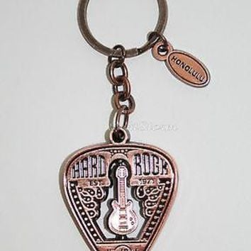 Licensed cool Hard Rock Cafe Honolulu Hawaii Spins Guitar Pick Copper Color Metal Keychain NEW