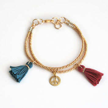 Golden beaded boho bracelet with tassel charms, peace charm bracelet, hippie bracelet
