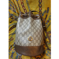 Vintage Gucci Plus monogram and leather hobo bucket purse with draw strings. Great masterpiece for your another Gucci collection. riri zip