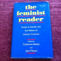 The Feminist Reader: Essays in Gender and the Politics of Literary Criticism by a variety of contributers. Feminist essay book with bracelet