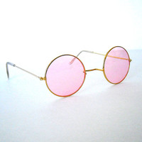 vintage pair of 1960's era round orange/pink hippie john lennon sunglasses