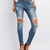 MACHINE JEANS MEDIUM WASH DESTROYED SKINNY JEANS