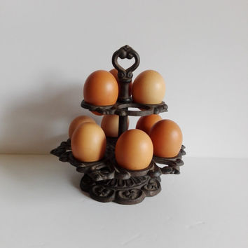 Antique support eggs in cast iron.  antique french bistro.
