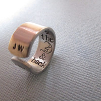 "I love you to the Moon and back"" ring stamped on the inside"