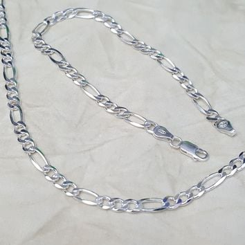 F120 Sterling Silver Italian Figaro Link, 5mm Wide, available in chain and bracelet.