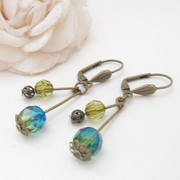 Vintage bronze earrings with blue-green gradient glass beads and filigree beads
