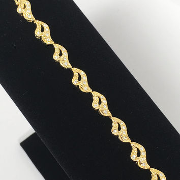Vintage 1960s 1970s Designer Signed Napier Tennis Bracelet, Gold Tone Curved Crescent Link Jewelry with Clear Prong Set Faceted Rhinestones