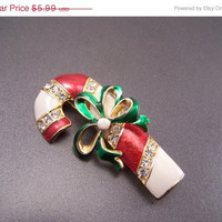 60% Blow out Enamel and Rhinestone Candy Cane Brooch