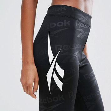 Reebok Classics Vector Logo Embossed Leggings at asos.com