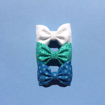 White denim, bright green floral, and blue-green polka dot Seaside Sparrow bow lot.  Perfect birthday gift for any girl.