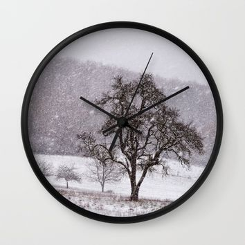 Old pear tree on a wintery meadow Wall Clock by Pirmin Nohr