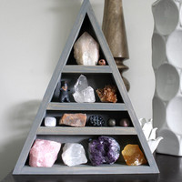 Large Crystal and Mineral collection in gray handmade elongated wood triangle shelf along with HandyMaiden Owl Sculpture