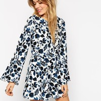 ASOS | ASOS Woven Playsuit with Flare Sleeve in Floral Print at ASOS