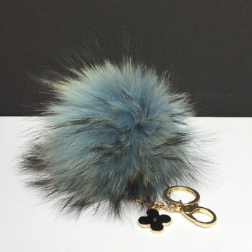 Fur Pom Pom keychain luxury bag charm pendant clover flower keychain keyring in light blue with natural dark tips