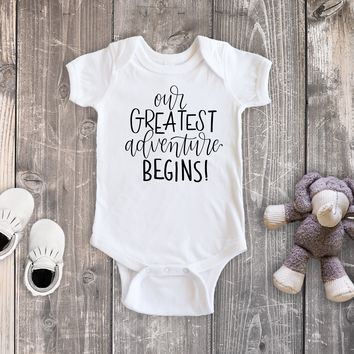 Our Greatest Adventure Begins Pregnancy Reveal White Bodysuit