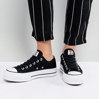 Converse Chuck Taylor All Star Platform Ox Trainers In Black at asos.com