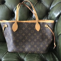 Louis Vuitton Neverfull PM Tote Bag Date code V14160. In very good condition
