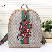 """Gucci"" Women Men Fashion Personality Classic Print Multicolor Stripe Snake Pattern Embroidery Backpack Large Capacity Double Shoulder Bag"