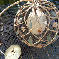 vintage hanging metal work with flowers ball light fixture from the 50's?