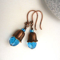 Cerulean blue & copper earrings of fluted bead caps, faceted crystal drops and fancy ear wires floral flower