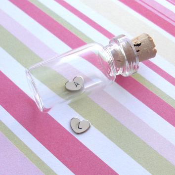 Itty Bitty Heart in Mini glass bottle with cork .. antiqued silver charm with One Initial .. 1 tiny little confetti sized baby heart ..