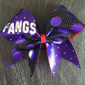 Purple and red bow with rhinestones and polka dots.