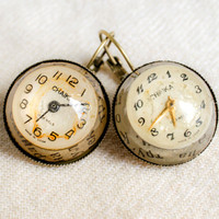 tiny watch vintage parts earrings with vintage newspaper on the background hemisphere shapes genuine watch parts mechanics white earring