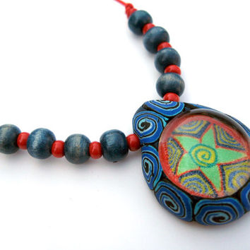 Millefiori pendant, polymer clay and glass, star and spirals, handmade, on red cord with red and blue beads, one of a kind