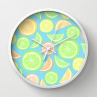 Mixed Citrus - blue Wall Clock by Lisa Argyropoulos