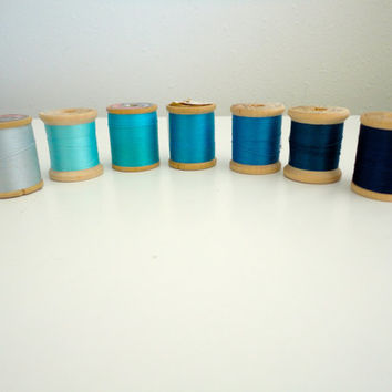 Vintage sewing thread lot of 7 wooden spools in hues of blue