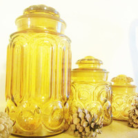 L.E. Smith Moon and Stars Set of Three Amber Glass Canisters Along with Matching Glass Lids In Excellent Conditions