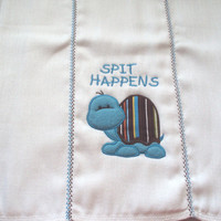 "Burp cloth ""Spit Happens"" A cute applique turtle in blues browns orange and yellow for boys. It can be personalized for an extra charge."