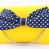 Yellow felt clutch bag with bow