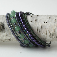 Beaded bracelet - stacking bangles - 8 coils of shimmering purple, blue & green, glass and stone beads