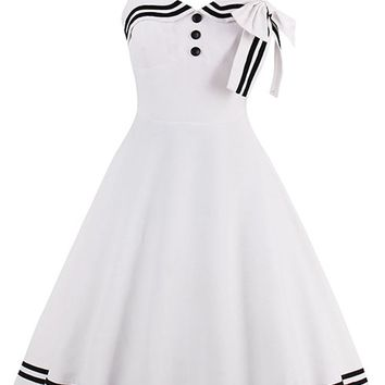 Atomic White Button and Bow Halter Swing Dress