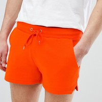 ASOS DESIGN Jersey Skinny Short With Cut Out Side Splits In Red at asos.com
