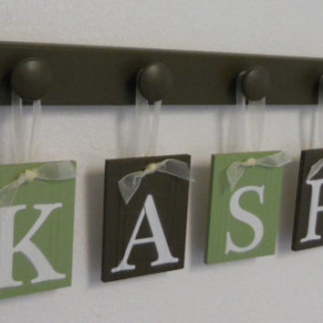 Personalized Children Decor Wooden Letters Includes 4 Peg Hooks and Custom Baby Name KASH Painted Light Green and Brown.